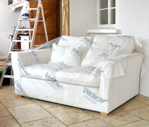 Packexe Interior Surface film protector on a sofa